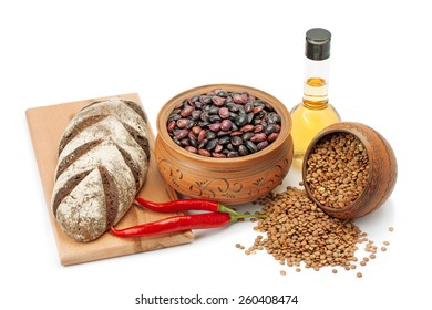 clay pots, legumes ,olive oil ,pepper and bread isolated on white background