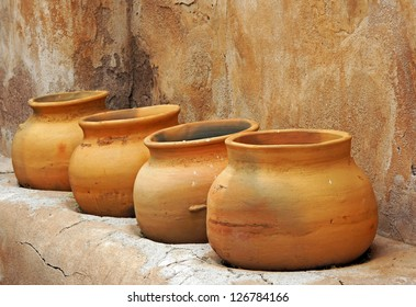 Clay pots on a shelf in the Tumacacori Mission store room