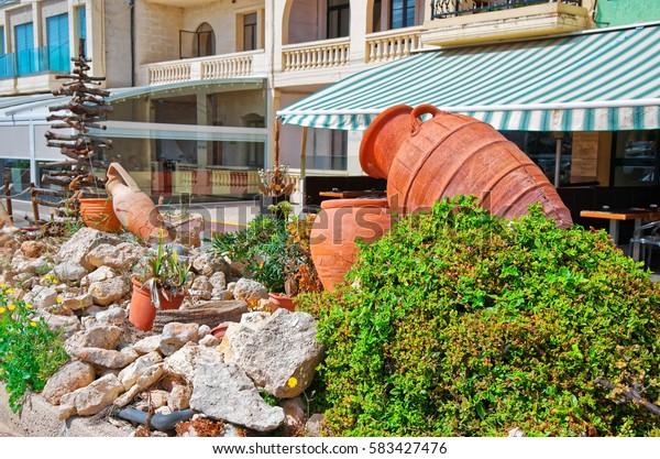 Clay pots in the street of Marsaxlokk, Malta island