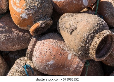 Clay pots used to catch octopus in a portuguese harbor
