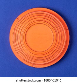 Clay target for skeet shooting against the blue background