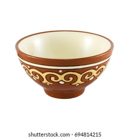 Clay tea (drinking, soup) bowl with a ornament pattern isolated over white background.