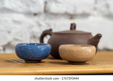 clay teapot for the tea ceremony. there are 3 ceramic tea files on the stand. Chinese tea ceremony. tea party