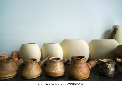 Clay utensils for cooking coffee. Manufacture of clay pots.