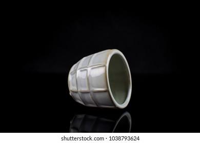 Clay vase isolated on black background.