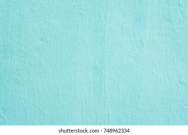 Clay wall is whitewashed by lime, textured background