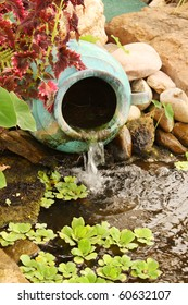 Clay water feature near a pond