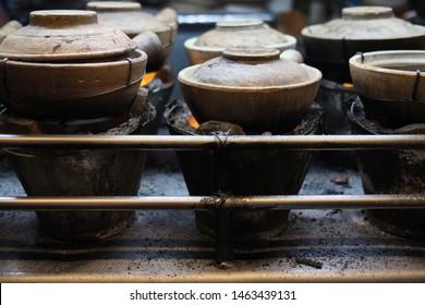 Claypot chicken rice cooking on hot coals, Kuala Lumpur