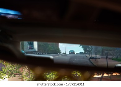 Clayton, Missouri / USA - May 23, 2020: Image of a tow truck in the rear view mirror.