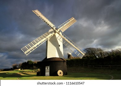 Clayton, Sussex, UK - December 27th 2009 : Dark sky behind the windmill on the Sussex Downs at Clayton
