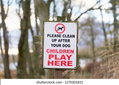 Clean up after dog children play here sign