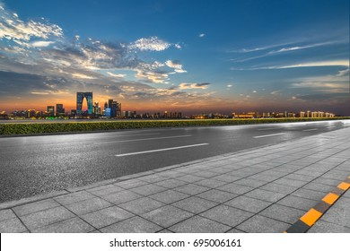 clean asphalt road with city skyline background, china.