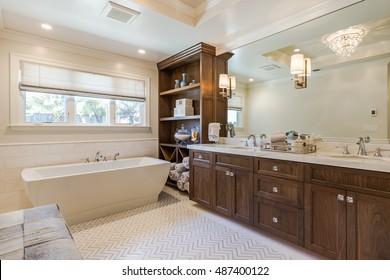 Clean Bathroom with custom cabinets