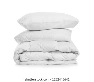 Clean blanket and pillows on white background