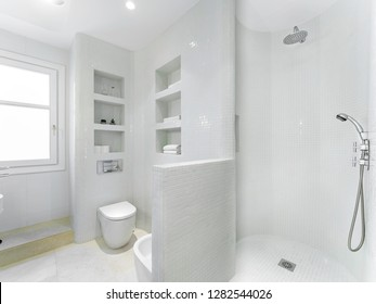 Clean bright bathroom interior with vintage steel faucet and white tiles. Original designed space with modern pieces