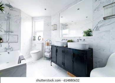 Clean bright stylish designer modern bathroom
