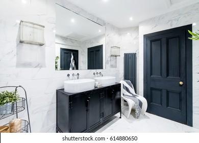 Clean bright stylish designer modern bathroom