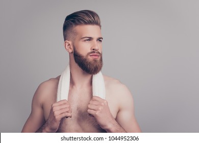 Clean clear cosmetics cosmetology morning face facial concept. Close up portrait of confident serious handsome brutal groomed macho holding white towel on neck with hands isolated on gray background