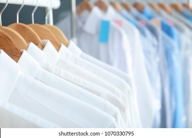 Clean clothes on hangers after dry-cleaning, closeup