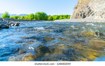 Clean cool fresh water of Waiau River and stony river bed at Hanmer Springs, New Zealand.
