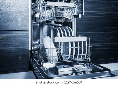 clean dishes and Cutlery in the dishwasher. work on cleaning the house. Toned image