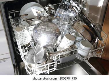 clean dishes in the drawer of a dish washer