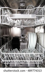 Clean dishes in a modern dishwasher machine