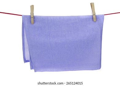 Clean Dry Violet Textured Towel Hanging On A Red Rope  Isolated On A White Background With Copy Space. You can use this image as signboard.