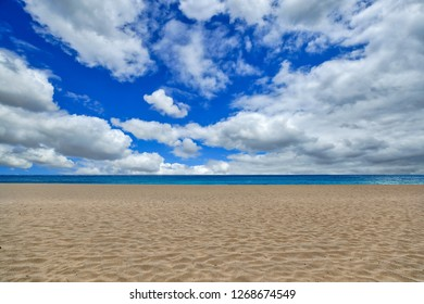 Clean Empty Beach Shot with Sky Clouds and Sand in Maui Hawaii