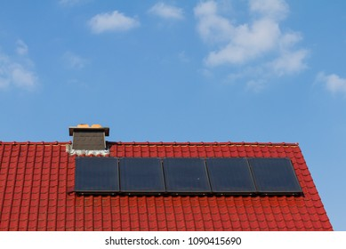 Clean energy by solar cells and photovoltaic on the rooftop with cloudy sky