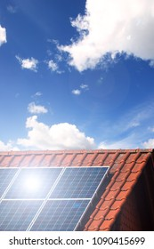 Clean energy by solar cells and photovoltaic on the rooftop with bright sun reflection