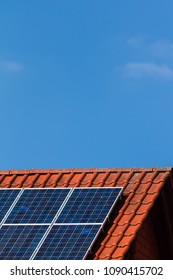 Clean energy by solar cells and photovoltaic on the rooftop with blue sky