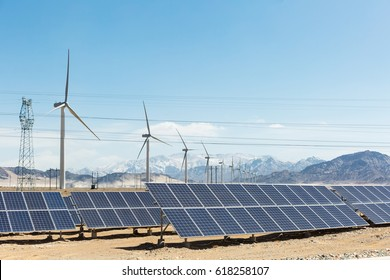 clean energy on snow area plateau, solar panels and wind power farm in golmud, China