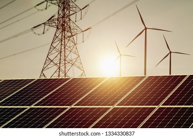 clean energy power concept solar panel with wind turbine and hight voltage electric tower