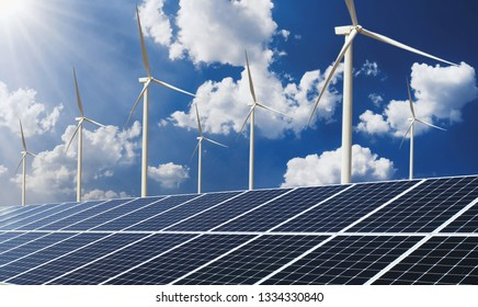 clean energy power concept solar panel with wind turbine and blue sky background