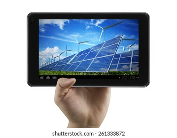 Clean energy, wind mills, solar panels show on digital tablet