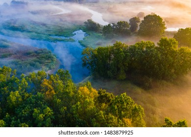 Clean environment concept. Blue river flows along green rural area, beautiful landscape