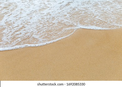 Clean fine sand beach and white wave background, nature concept, outdoor day light, summer concept background