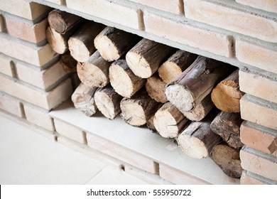 Clean fireplace filled with recently chopped wood