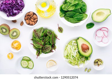 Clean food. Fresh raw vegetables and lettuce leaves to prepare a healthy snack meal salad. Top view. On a light background