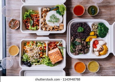 Clean food meal boxes: rice and rice berry with beef, salmon and chicken in various vegetables and salad for good health.