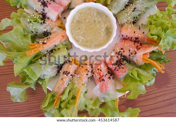 clean food salad roll with seafood sauce on dish put on wood table good for healthy