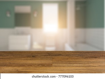 Clean and fresh bathroom with natural light.  The wooden table. Blurred interior.