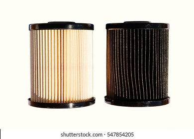 A clean and fresh out of the box diesel fuel filter on the left in contrast with an old and dirty filter on the right. The dirty filter had 15,000 miles use.