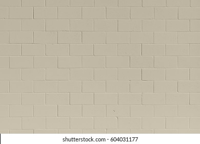Clean, freshly painted, tan, generic, brick cinder block wall background.