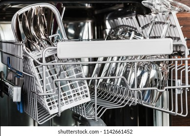 clean glasses and Cutlery in the dishwasher. work on cleaning the house