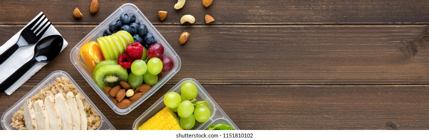 Clean healthy oil-free low fat ready to eat food in takeaway meal box sets on wood banner background top view with copy space