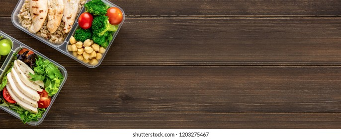 Clean healthy oil-free low fat ready to eat food in takeaway meal box sets on wood table background top view with copy space