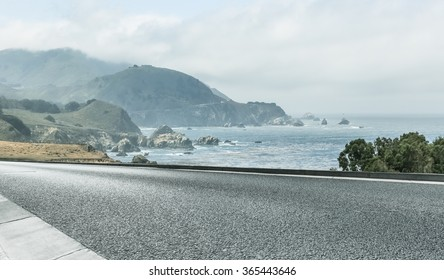 clean highway go aside the bay of ocean, california, usa.