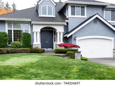 Clean home exterior during Autumn season with well maintain front yard